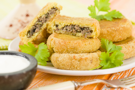 chap: Batata Chap - Middle Eastern potato croquette filled with lamb. Arab traditional street food. Stock Photo