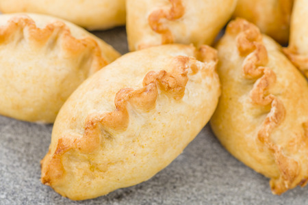 pasty: Cornish Pasty - Baked pasty filled with meat and potatoes. Cornwalls traditional dish.