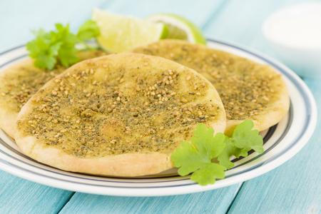 lebanese food: Zaatar Manakish - Flatbread topped with zaatar and olive oil. Traditional Arab food.