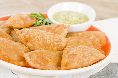pasty: Empanadas - Spanish fried pasty filled with chorizo and cheese served with a garlic, coriander and olive oil dip.