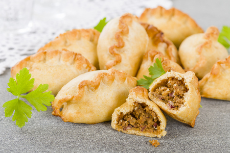 baked meat: Cornish Pasty - Baked pasty filled with meat and potatoes. Cornwalls traditional dish.