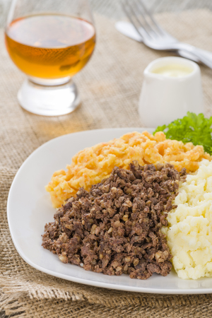 dram: Haggis, Neeps  Tatties - Traditional Scottish meal commonly served at Burns Night. Served with a dram and whisky sauce. Stock Photo