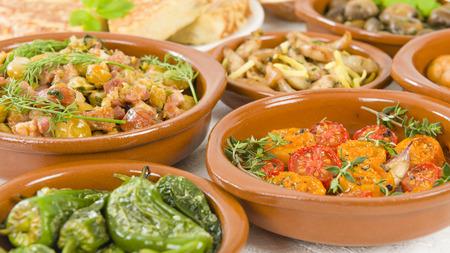 limon: Spanish Tapas  Bread - Tomates al Ajillo Tomatoes with garlic, Pollo al limon con ajo chicken with garlic and Padron Peppers.