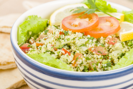 tabbouleh: Tabbouleh - Arabic salad made with bulghur wheat, tomato, cucumber, onions, parsley and min and seasoned with lemon juice and olive oil.