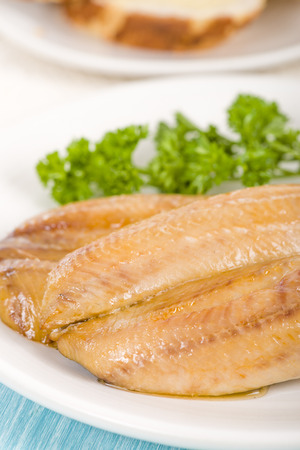 uk cuisine: Smoked Kippers - Butterfly smoked herring served with bread. Stock Photo