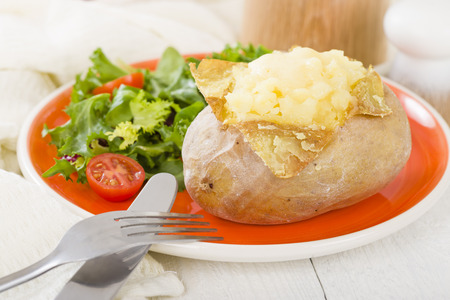 pomme: Jacket Potato - Baked potato topped with cheese and served with salad.