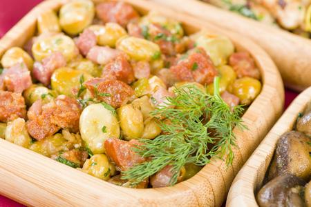 chorizo: Habas Con Chorizo - Broad beans with chorizo and serrano ham. Traditional Spanish tapas dish. Stock Photo