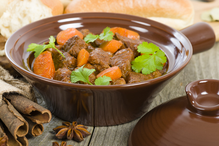 'vietnamese: Bo Kho - Vietnamese beef stew cooked with lemongrass, star anise, bay leaf and cassia bark served with crusty bread. Stock Photo