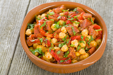 Garbanzos y Chorizo - Chickpeas and spicy sausage with red peppers tapas. Traditional Spanish dish.