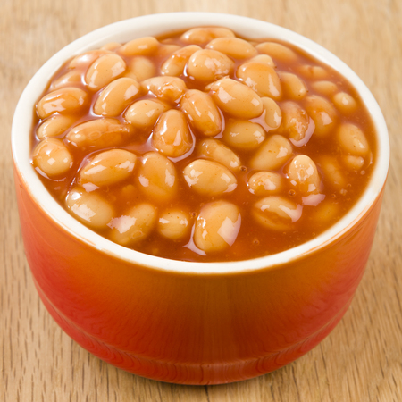pinto bean: Baked Beans - Bowl of baked beans in tomato sauce