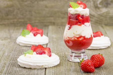 eton mess: Eton Mess - Strawberries with whipped cream and meringue. Classic British summer dessert. Stock Photo