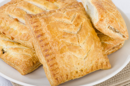 pasty: Pasties - Selection of traditional British pasties - sausage rolls, steak and gravy bake, cheese and onion pasty.