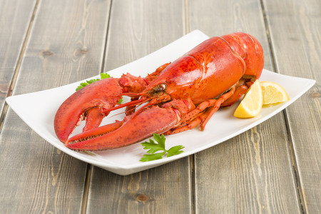 lobster dinner: Lobster with lemon wedges.