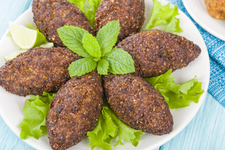 Kibbeh - Middle Eastern minced meat and bulghur wheat fried snack. Also popular party dish in Brazil kibe. Reklamní fotografie