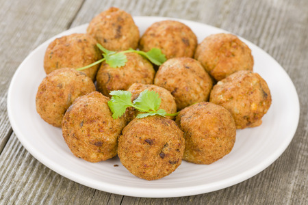 middle easter: Falafel - Middle Eastern chickpea and fava beans fried balls served with tzatziki. Traditional spicy snack. Kibbeh on background.