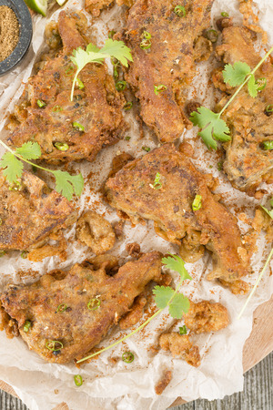 chaat: Mutton Chaap - Fried battered spicy lamb cutlets garnished with green chilies, coriander and chaat masala.