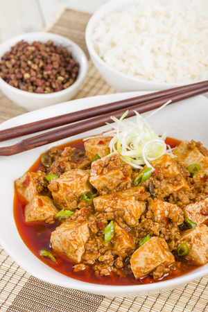 doufu: Mapo Tofu - Tofu and minced pork cooked with chili bean paste, fermented black beans, chili oil and Szechuan peppers, garnished with spring onions.