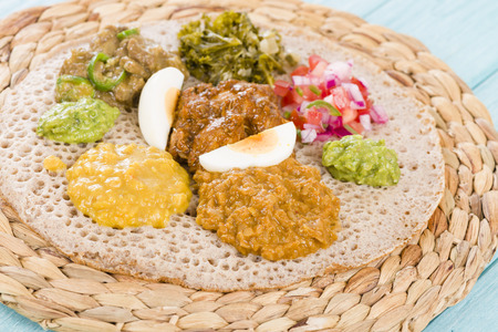 Ethiopian Feast - Injera sourdough flatbread with doro wat red chicken stew, yebeg alicha mild lamb stew, misir wat red lentils puree, kik alicha yellow split peas and gomen collard greens