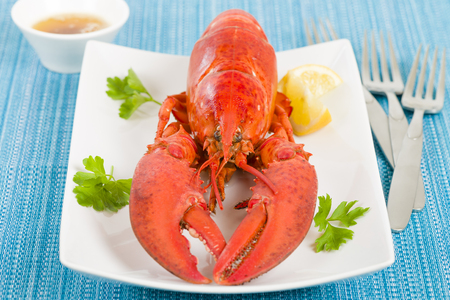 browned: Lobster with browned butter and lemon wedges.
