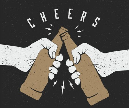 Two hands friends holding beer bottles and making cheers.
