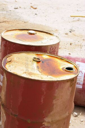Oil barrels in the Qatari desert (the Arabic words on the side of the barrels are partly deleted and are unreadable)