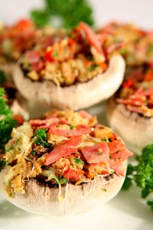 breadcrumbs: Mushrooms, stuffed with ham, red bell pepper, onion, parsley and breadcrumbs.