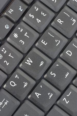 El teclado de una computadora permitida �rabe, demostrando letras �rabes. Foto de archivo - 262112
