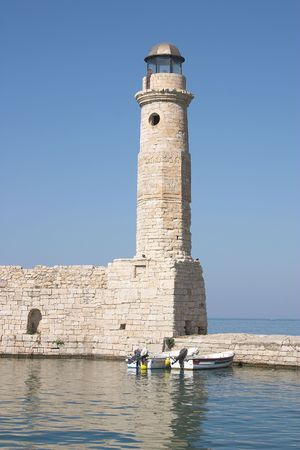 rethymno: The lighthouse on the Old Harbour wall at Rethymno, on the Greek island of Crete Stock Photo
