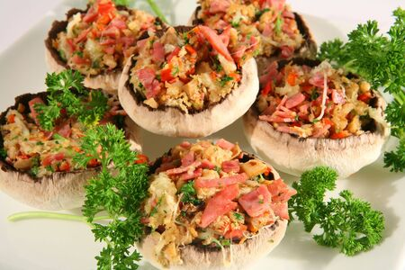 Mushrooms stuffed with ham, capsicum, onion and parsley, ready for the oven Stock Photo