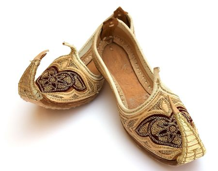 A pair of miniature Persian or Arab shoes in the Aladdin style. photo