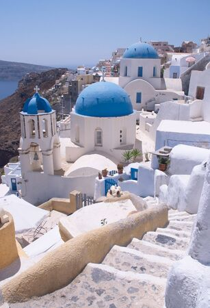 ia: The famous churches at Oia (or Ia) on Santorini. Stock Photo