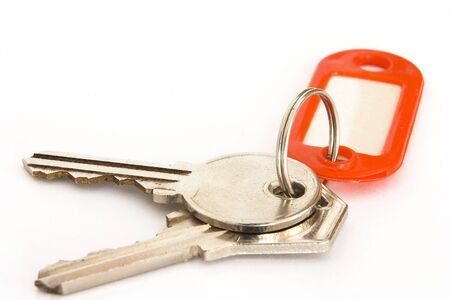 insure: House keys on a ring with a blank tag