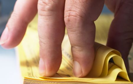 flicking: Flicking through the Yellow Pages Stock Photo