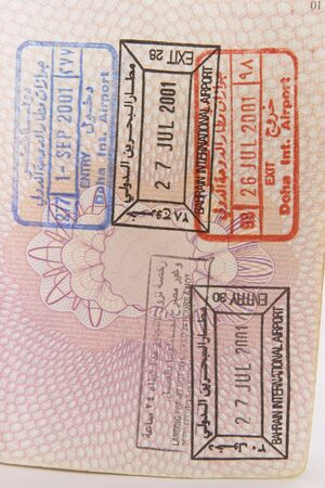 Entry and exit stamps for Bahrain, in a British passport.