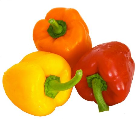 Three brightly coloured bell peppers