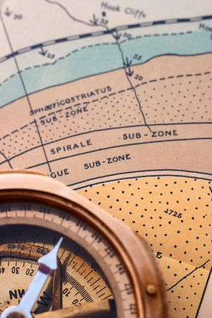 prospecting: Surveying compass on a geological map