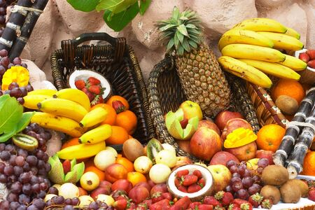 fruit display featuring many different fruits. Stock Photo