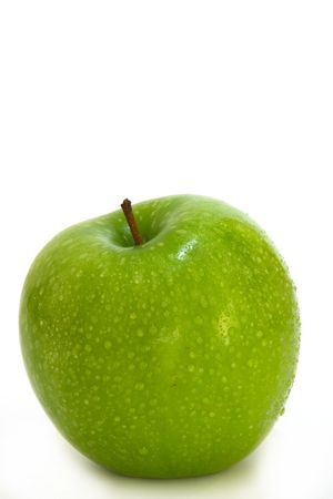 green apples: The famous Granny Smith variety of apple, coated with water droplets. Stock Photo