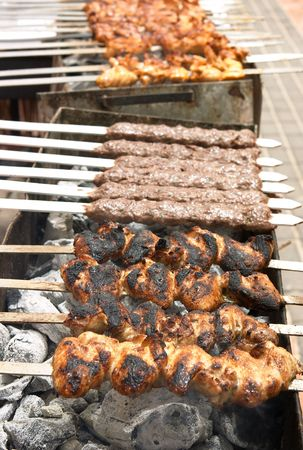 An Arab-style barbecue with chicken kebabs, kofta and chicken legs.