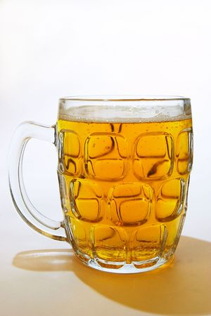 A glass of beer in a British-style mug