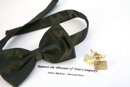 bow tie: Bow tie, gold cufflinks and an invitation to a black tie event