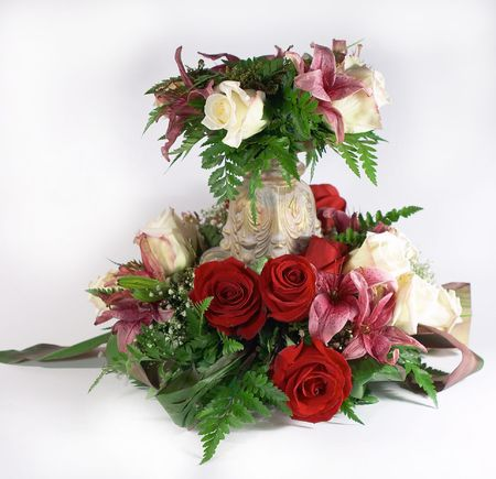 An arrangement of flowers with a gift tag photo