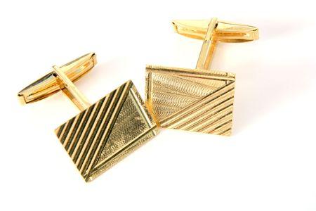 A pair of gold cufflinks