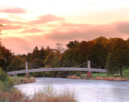 tweed: A view of the footbridge over the River Tweed at dawn from Tweed Green, Peebles.