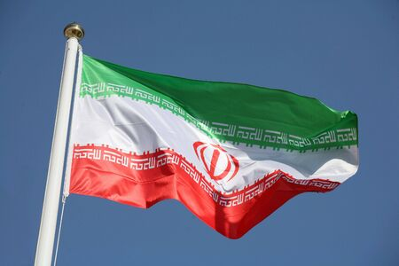 The national flag of the Islamic Republic of Iran photo
