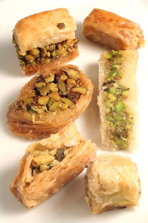 middle east: A plate of traditional Arab or Lebanese pastries, which are a popular treat throughout the Middle East and Eastern Mediterranean.