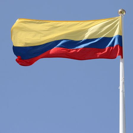 flagpoles: The red, yellow and blue flag of Colombia, South America. Stock Photo