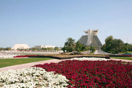 conference centre: A hotel in Qatar, from the roundabout at the entrance, across a sea of petunias (Feb 2007). The building on the left is the Conference Centre.