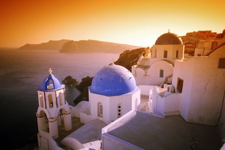 A surreal sunset effect over some of Santorinis world-famous churches. Stock Photo