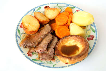 Traditional British Sunday lunch of roast beef, Yorkshire pudding, roast and boiled potato, carrots and gravy Stock Photo - 809889